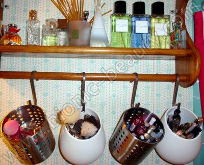 Hanging storage for makeup brushes, mineral makeup, mascaras, and eyeliners - shelf storage for favorite perfumes