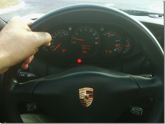 tim driving a porsche carrera