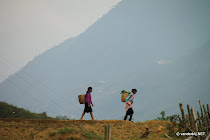 Two Vietnamese women coming home from working the fields in Sin Chai, Vietnam