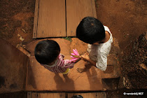 Two children at Banteay Srei. One has just taken a flower from the pond