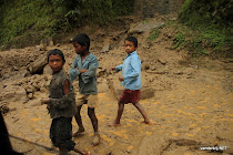 Nepalese children playing in the mud along the road from Kodari (Tibet border) to Kathmandu