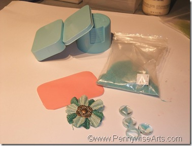 2. Cut O'So to fit lid; choose embellishments