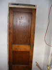 Original door reused for the coat closet