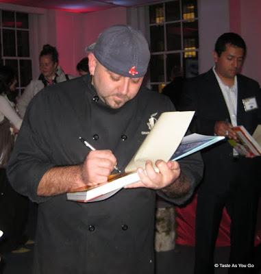 Duff Goldman signs Tyler Florence's copy of the Ace of Cakes Book - Photo by Taste As You Go