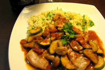 Seared Pork Cutlets with Mushroom and Zucchini in a Red Wine Tomato Pesto Sauce on Lemony Couscous - Photo by Food Tastes Yummy