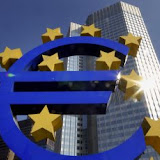 **  FILE ** In this Sept. 24, 2007 file picture, the Euro sculpture, the autumnal sun, is seen in front of the European Central Bank ECB building, background, in Frankfurt, Germany. Ten years ago, Europe launched its grand experiment with a shared currency and watched it plunge so far it needed a bailout from central banks. But as the anniversary approaches of the Jan. 1, 1999, arrival of the euro, economists say the new currency is finally fulfilling its promise as a way to lower borrowing costs, ease trade and tourism, boost growth and strengthen the European community. (AP Photo/Bernd Kammerer, File) GERMANY EURO AT 10