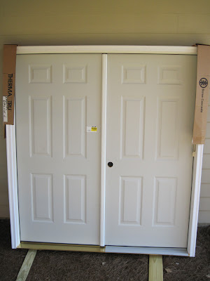 ... I wanted the doors but I decided to try one more time to call local Lowes to see what they had. Well it took 7 stores but I finally got a hit & New double doors into my workshop - The SawdustZone