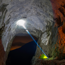 camping in the cave by Adrian Urbanek - Landscapes Caves & Formations ( amphitheater, tents, night, cave, light )