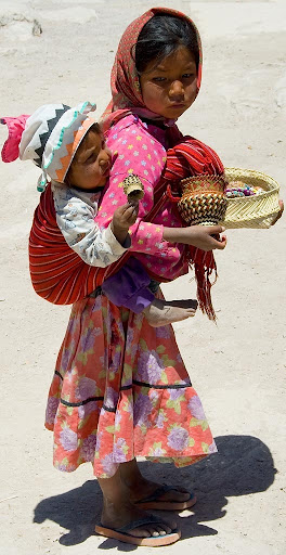 tarahumara_girl_carrying_her_brother.jpg