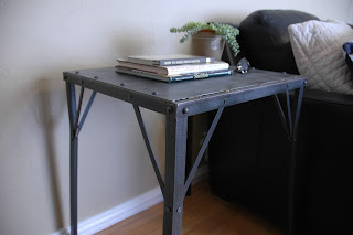 "Inspired from the French industrial era (circa 1950s), this table is constructed entirely of iron and is riveted together for a rugged industrial / retro look. It looks vintage but not beat up. The top measures 20"" x 18"" and it is 26"" tall making it ideal to use as a side table or an accent table. Priced at $275, contact Greg at 602-330-1234 for more information."