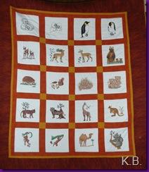 Quilt mit Kreuzstichbildern