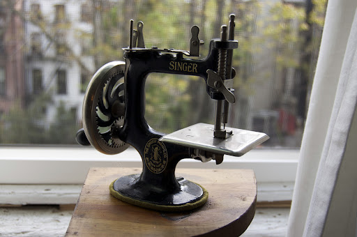 Anne brought this antique Singer sewing toy for everyone to see. The toy was designed for kids to sew alongside their mothers.