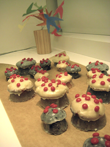 I think Jodi made these adorable mushroom cupcakes- red hots dot the tops.