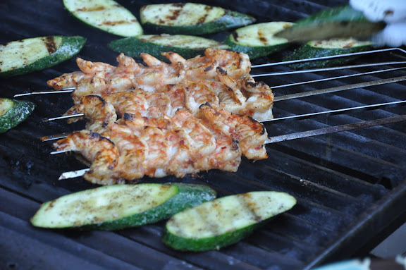 The shrimp grills for about 7 minutes total, turning a couple of times and rotating placement so that they all cook evenly, depending on where the grill is hottest.