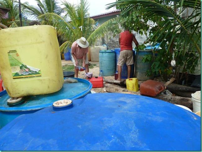 P1030019 Nargana siphoning gasoline gallon jugs