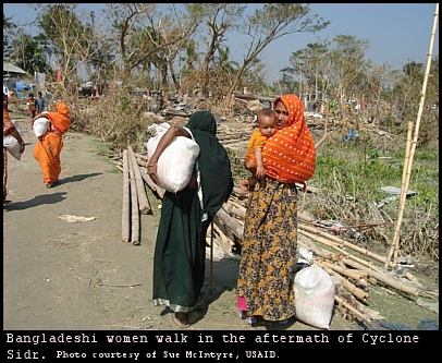 Bangladeshi women flee the destruction of Cyclone Sidr