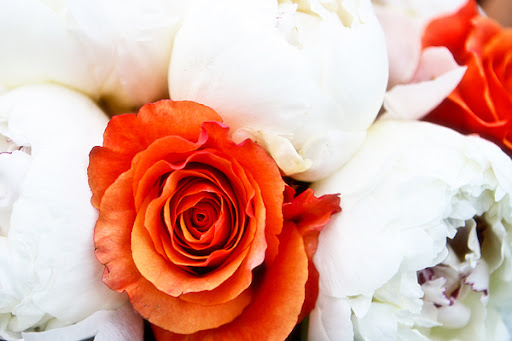 The wedding colors were orange aqua and white The deep orange roses and