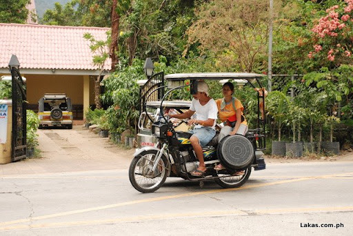 Tricycle passing by Tanauan-Talisay National Road