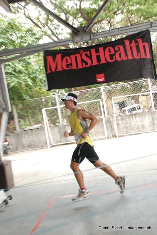 man finishing w/ men's health in the background