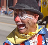 Cody Nite Rodeo clown Butch Lehmkuhler makes faces at kids.
