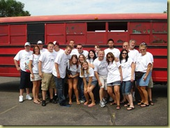 group picture in front of bus
