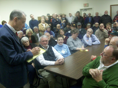 U.S. Senator Chuck Grassley (R-New Hartford) jots down notes from one of the hundreds in attendance at the town hall meeting in Kalona (1/13/10) - KCII NEWS
