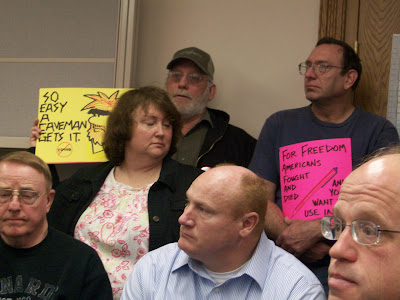 Free County Members protest at a Supervisors Meeting earlier this year