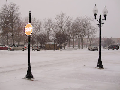 The camera flash lights up a new stop sign downtown. December 16, 2008. Washington, Iowa. (Ben Stanton/KCII)