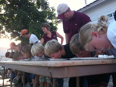 Kids Participating In The Washington County Fair Pie Eating Contest.