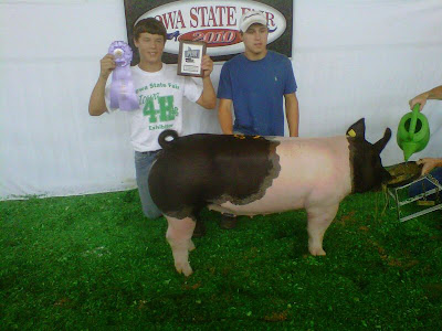 Keota's Kolton Greiner (left) with brother Keaton after winning 4-H Reserve Champion Commercial Gilt for Washington County at the Iowa State Fair.<br />