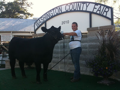 Joni Erwin Posing For Photos After A Win At This Year's Washington County Fair.  Erwin Will Show Cattle This Weekend And Early Next Week At The Iowa State Fair.<br /> (KCII's Chance Dorland)