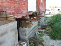 The back wall of the building is in very poor condition.  There are many missing bricks and voids in the mortar.<br /> (Washington City Hall)