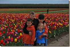 happy kids in front of tulips