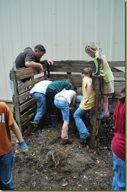 kids digging in the compost