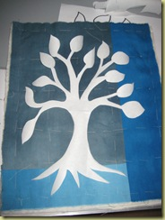 first piece with freezer paper tree ironed in place - ready to go on to the stitching stage