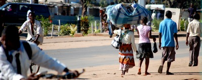Woman carrying load on her head in Massinga, Mozambique
