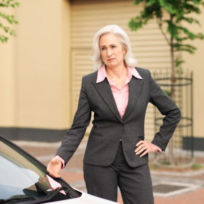 A business woman frustrated over a parking ticket.