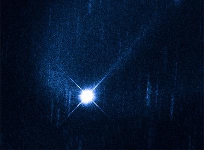asteroide Scheila circundado por uma nuvem de partículas