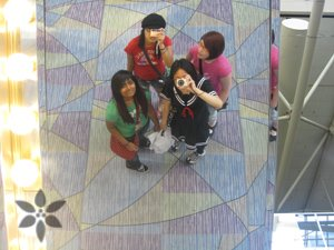 Traditional under the escalator mirror picture pose