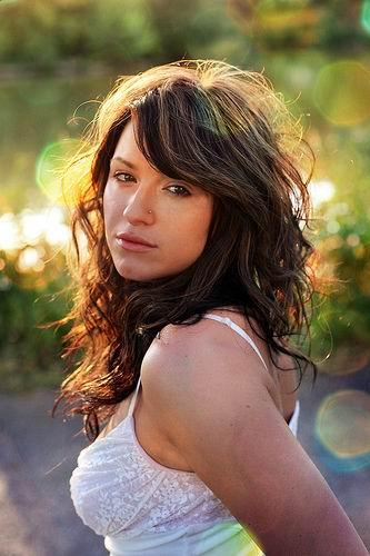 Short hairstyles 2013-2014: Long layered wavy curly hair with bangs
