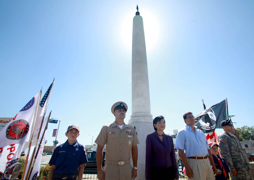 Eastside Memorial Day photo. From left, Cub Scout Jonathan Ruiz, 10, CPO David Jimenez, Congresswoman Judy Chu, LA City Councilman José Huizar, Cub Scout Andrew Ruiz, 7, and PFC Timothy Veloz were the first watch at the 24-hour patriotic vigil at the Mexican All Wars Memorial at Cinco Puntos in Los on Sunday March 30, 2010. 63rd Annual Memorial Day observance and Commemoration of Medal of Honor Recipient PFC Eugene Obregon USMC. The event includes a 24-hour patriotic vigil at the Mexican All Wars Memorial at Cinco Puntos (Intersection of Lorena, Indiana, and Chavez) in Los Angeles. PHOTO BY AURELIO JOSE BARRERA