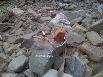 A twisted tricycle on the ruin.