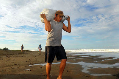 Man Carrying A Sack Filled With Turtle Eggs