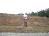 A typical monitoring well. AEM's Field Manager, Eric Benton, enters data in a handheld computer. The electronic data is e-mailed to AEM's project managers to provide quicker QA/QC and report preparation.