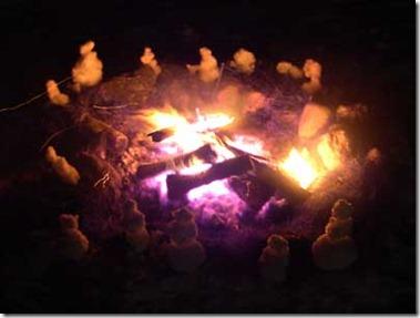 Snowmen by Blue Fire