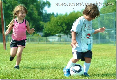 Two of Ty & Mamayuv's kids playing soccer