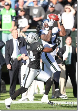 31 October 2010: Seattle Seahawks wide receiver Mike Williams (17) catches a pass over Oakland Raiders safety Michael Huff (24) as the Raiders beat the Seahawks 33-3 at the Oakland-Alameda Coliseum in Oakland, Ca ***FOR EDITORIAL USE ONLY****
