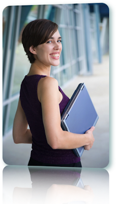 Woman with short hair holding a laptop.