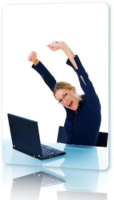 Happy woman sitting in front of a laptop.