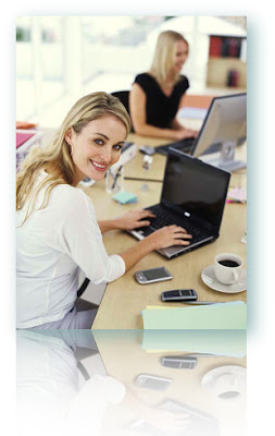 A smiling woman using a computer to request installment loans for bad credit.